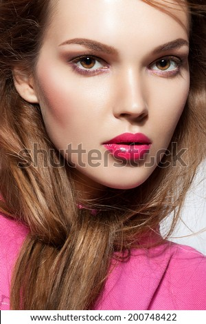 beautiful young woman with pink lips and healthy skin. Trendy summer makeup - stock photo