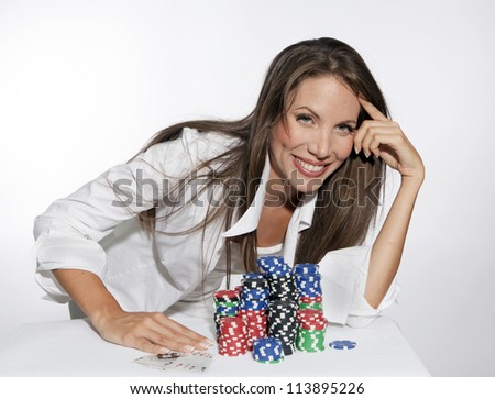 Beautiful Young Woman with Poker Chips on white background - stock photo