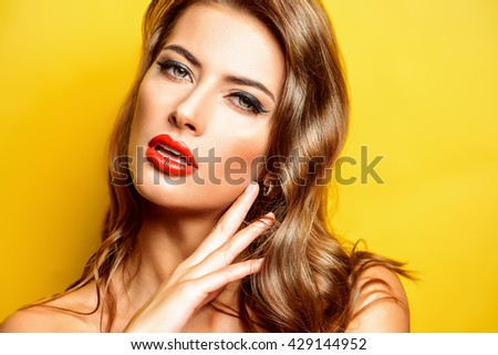 Beautiful young woman with red lips over yellow background. Beauty, fashion. Cosmetics, make-up. - stock photo