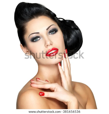 Beautiful young woman with red nails and fashion makeup - isolated on white background - stock photo