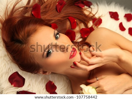 beautiful young woman with roses - stock photo