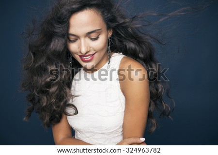 beautiful young woman with shine hair and bright makeup smiling. Make up and cosmetics concept. studio shot, horizontal - stock photo