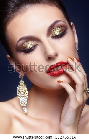Beautiful young woman with shining face makeup  - stock photo
