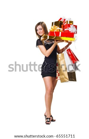 beautiful young woman with shopping and gifts. isolated on white - stock photo