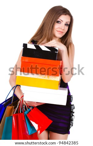 Beautiful young woman with shopping bags and gifts. isolated on white - stock photo