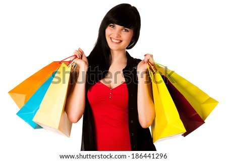 Beautiful young woman with shopping bags isolated over white - stock photo