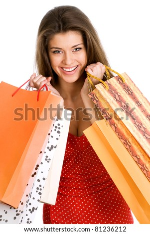 Beautiful young woman with shopping bags over white - stock photo