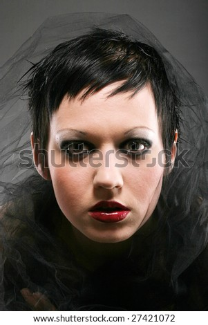 Beautiful young woman with short dark hair - stock photo