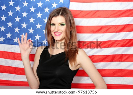 beautiful young woman with the American flag on the background