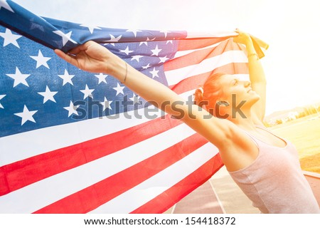Beautiful Young Woman with USA Flag - stock photo