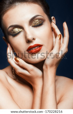 Beautiful young woman with vogue shining face makeup