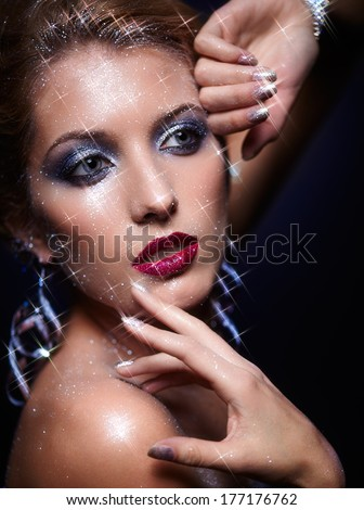 Beautiful young woman with vogue shining sparkle face makeup  - stock photo