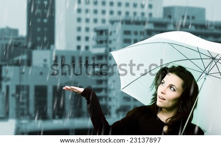 Beautiful young woman with white umbrella on rainy day - stock photo
