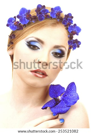 Beautiful young woman with wreath of flowers - stock photo