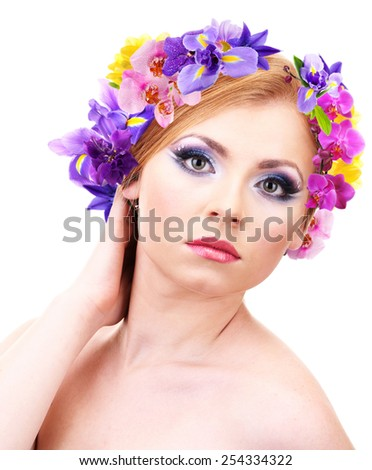 Beautiful young woman with wreath of flowers isolated on white - stock photo