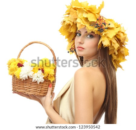 beautiful young woman with yellow autumn wreath and basket with flowers, isolated on white - stock photo