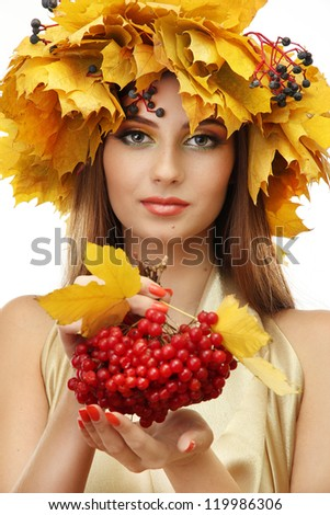 beautiful young woman with yellow autumn wreath and viburnum, isolated on white - stock photo