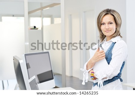 beautiful young woman working at the office - stock photo