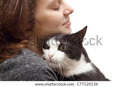 beautiful young woman 20 years  with monochrome black and white cat - stock photo