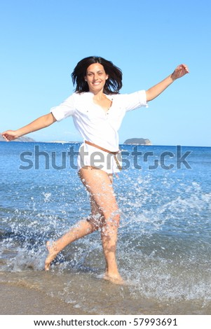 Beautiful young womand posing by the sea in Greece - stock photo