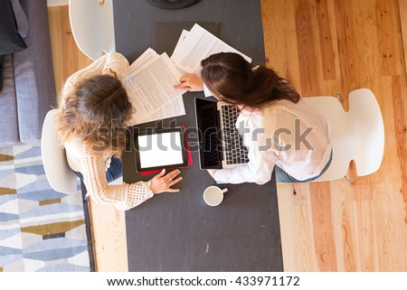 Beautiful young women at home studying for the final exams - stock photo