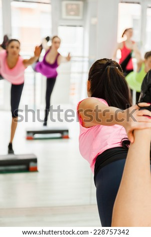 Beautiful Young Women Exercising At Fitness Center