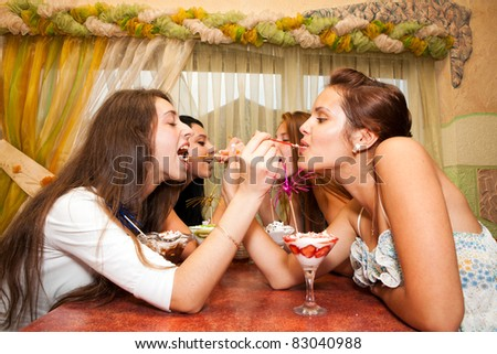 Beautiful young women in the caffee - stock photo