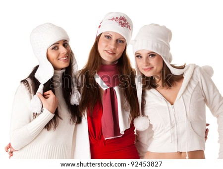 Beautiful young  women in winter clothes on a white background.