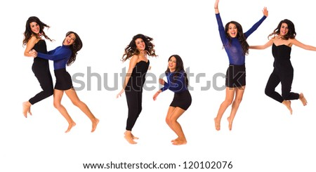 Beautiful young women jumping and having fun on a white background. - stock photo