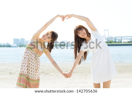 Beautiful young women on beach summer holiday - stock photo