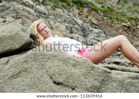 Beautiful young women on the beach - stock photo
