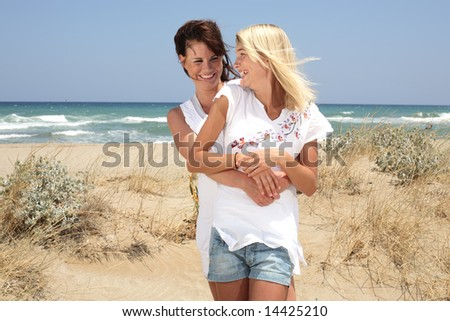 beautiful young women on the beach - stock photo