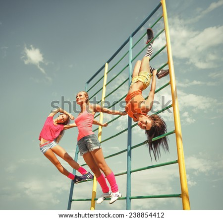 Beautiful young women on the sports ground. - stock photo
