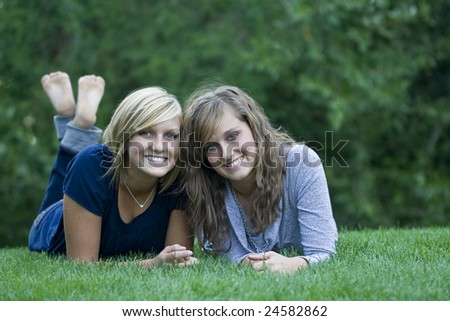 beautiful young women relaxing on the grass - stock photo