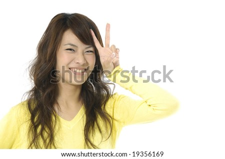 Beautiful young women showing victory sign gesture - stock photo
