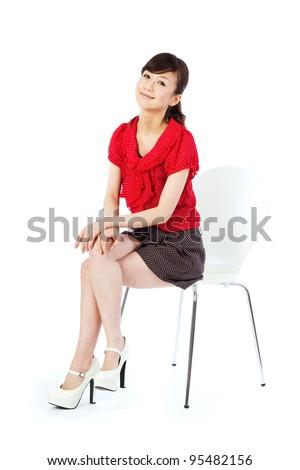 Beautiful young women sitting chair. Portrait of asian woman. - stock photo