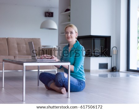 beautiful young women using laptop computer on the floor of her luxury home