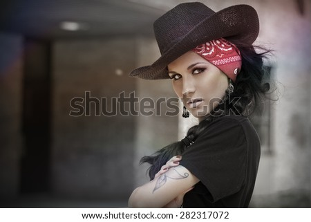 beautiful young women with a cowboy hat - stock photo