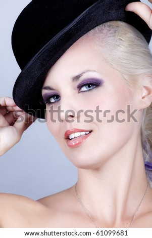 beautiful young women  with blue eyes wearing a hat