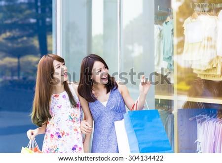 Beautiful Young Women with Shopping Bags - stock photo