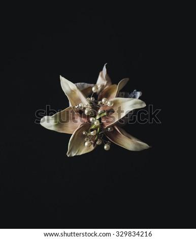 Beautifull boutonniere flower on black background. wedding boutonniere - stock photo