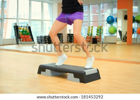 Beautifull female legs on the step board during exercise - stock photo