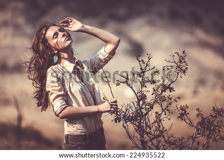 beautifull woman near the dry tree - stock photo