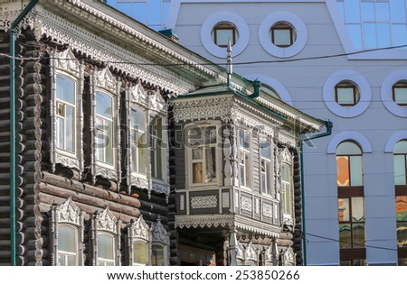 Beautifully carved old colored house window, Tomsk, Russia - stock photo