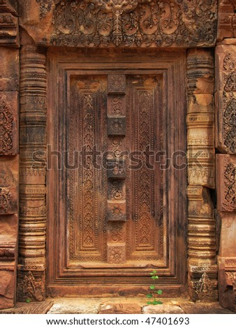 Beautifully carved stone door at the Banteay Srei temple (temple of women) near Angkor Wat (Siem Reap, Cambodia).