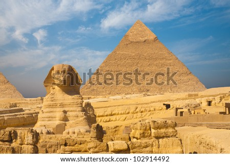 Beautifully clear blue sky behind the front face of the Great Sphinx and Khafre Pyramid side by side in Giza, Cairo, Egypt. Horizontal copy space - stock photo