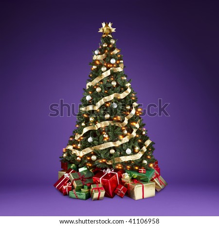 Beautifully decorated christmas tree with lights, ribbons and ornaments shot on a rich violet background with copy space - stock photo
