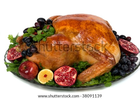 Beautifully decorated golden roasted turkey for Thanksgiving or Christmas