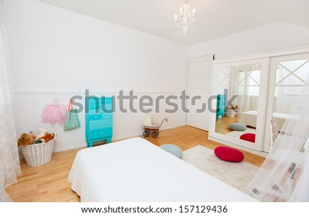 Beautifully decorated little girl room interior - stock photo