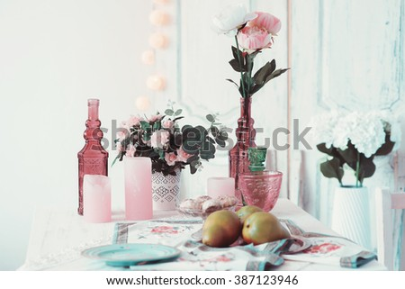 Beautifully decorated table adorned with flowers and pears - stock photo